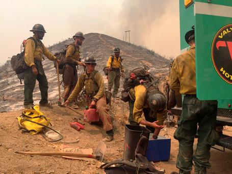 USDA Forest Service firefighters with the Valyermo Hotshots of Angeles National Forest prepare to head out again on Little Tujunga Canyon Road near the Wildlife Waystation in Santa Clarita, Calif., Saturday, July 23, 2016