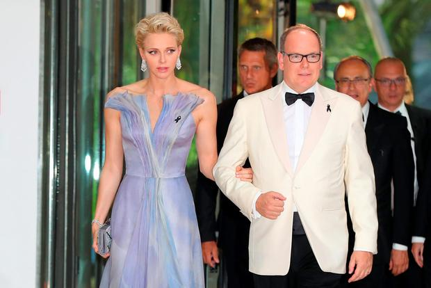 Prince Albert II of Monaco (R) and Princess Charlene arrive to attend the 68th annual Red Cross Gala