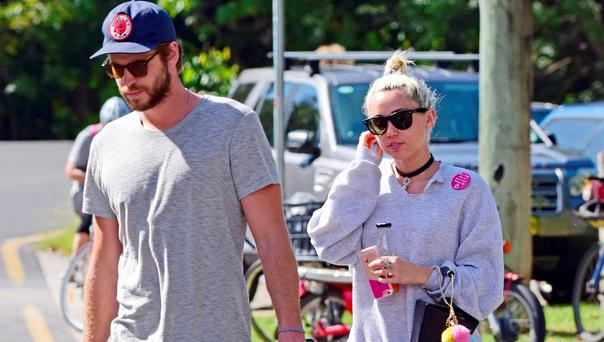 Liam Hemsworth and Miley Cyrus. (Photo by Matrix/GC Images)