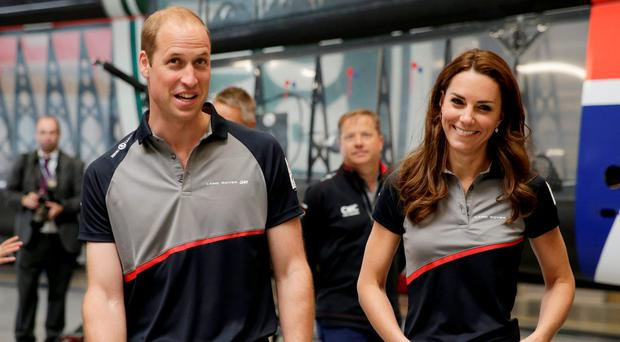 Britain's Kate, Duchess of Cambridge and Prince William in the Land Rover BAR boat shed. Picture: Reuters / Henry Browne