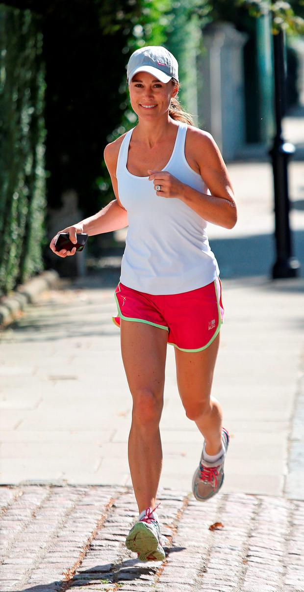 Pippa Middleton, sister of the Duchess of Cambridge goes for a run outside her London home a day after she announced her engagement to financier James Matthews. Picture: Philip Toscano/PA Wire