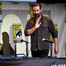 "Colin Farrell walks on stage at the ""Fantastic Beasts and Where to Find Them"" panel on day 3 of Comic-Con International"
