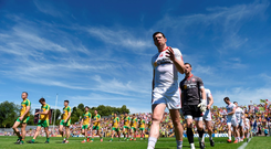 Sean Cavanagh leads Tyrone against Donegal last year
