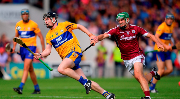 Tony Kelly of Clare in action against David Burke of Galway