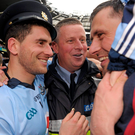 Bernard Brogan, left, and Alan Brogan, Dublin, celebrate with former Dublin manager Paul Caffrey after winning 2011 All Ireland