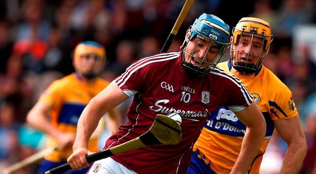 Galway's Conor Cooney goes past Clare's Cian Dillon on his way to scoring his side's first goal during their All-Ireland quarter-final in Thurles. Photo: Ray McManus/Sportsfile