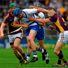 Waterford centre-back Austin Gleeson shows his determination as he fends off the challenges of Wexford pair Matthew O'Hanlon and Diarmuid O'Keeffe during yesterday's All-Ireland SHC quarter-final in Semple Stadium. Photo: Ray McManus/Sportsfile