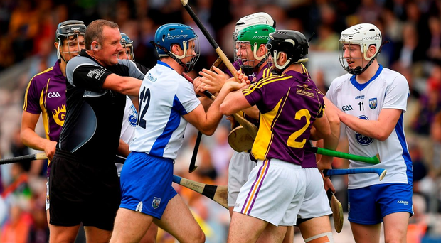 Referee Alan Kelly tries to seperate players from both sides. Photo: Ray McManus/Sportsfile