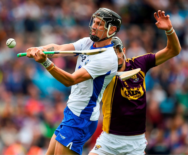 Maurice Shanahan of Waterford in action against Jack O'Connor of Wexford. Photo: Daire Brennan/Sportsfile