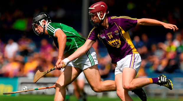 Wexford's Mark O'Neill tries to dispossess Ciarán O'Connor of Limerick during yesterday's Electric Ireland All-Ireland MHC quarter-final at Semple Stadium. Photo: Ray McManus/Sportsfile