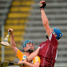 Cian Salmon of Galway makes a fine catch ahead of Antrim's Conor Carson. Photo: Oliver McVeigh/Sportsfile