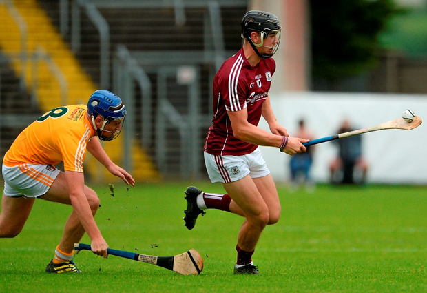 Jack Canning of Galway in action against Daniel Black of Antrim. Photo: Oliver McVeigh/Sportsfile