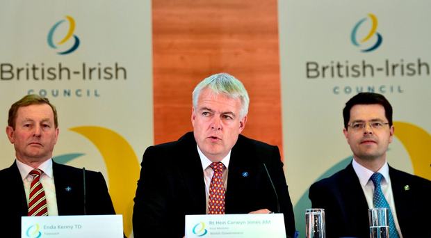 Enda Kenny (left), Secretary of State for Northern Ireland James Brokenshire (right) and Wales First Minister Carwyn Jones at an emergency meeting of the British Irish Council in Cardiff Photo: Ben Birchall/PA