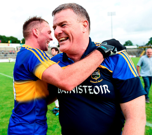 Tipperary manager Liam Kearns celebrates with Peter Acheson. Photo: Oliver McVeigh/Sportsfile