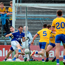Clare's David Tubridy turns to fire home his side's first goal during their game against Roscommon. Photo: Brendan Moran/Sportsfile