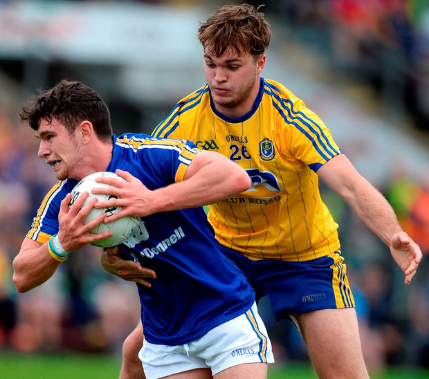 Cian O'Dea of Clare in action against Ultan Harney of Roscommon. Photo: Brendan Moran/Sportsfile