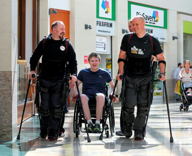Jack Kavanagh joins Dale Messenger from Gloucester and adventurer Mark Pollock from Co Down at the launch of the EKSO bionic suit in Dublin. Photo: Frank Mc Grath