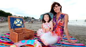 Emily Hourican with her daughter Bee (5) pictured at Seapoint Strand in Co. Dublin. Photo: Gerry Mooney.