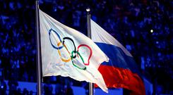 The Olympic flag and Russian flag. Photo: Paul Gilham/Getty Images
