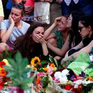 Young people mourn outside the Olympia shopping mall in Munich, Germany, the scene of a mass shooting on Friday Photo: Arnd Wiegmann/Reuters