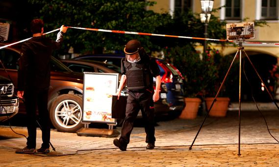 Police secure the area after an explosion in Ansbach, near Nuremberg, Germany July 25, 2016. REUTERS/Michaela Rehle