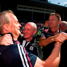 Galway manager Míchéal Donoghue, left, is congratulated at the final whistle