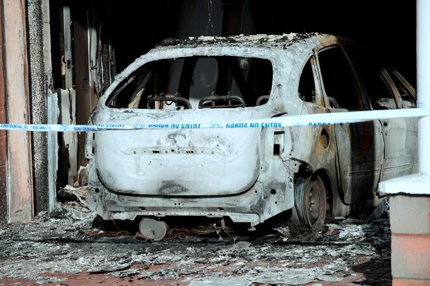 Burnt-out car and fire damage at entrance of Flyefit gym. Coolock retail park, Malahide Road, Dublin.