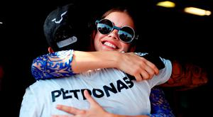 Lewis Hamilton of Great Britain and Mercedes GP gets a congratulatory hug from model Barbara Palvin during the Formula One Grand Prix of Hungary at Hungaroring on July 24, 2016 in Budapest, Hungary. (Photo by Mark Thompson/Getty Images)