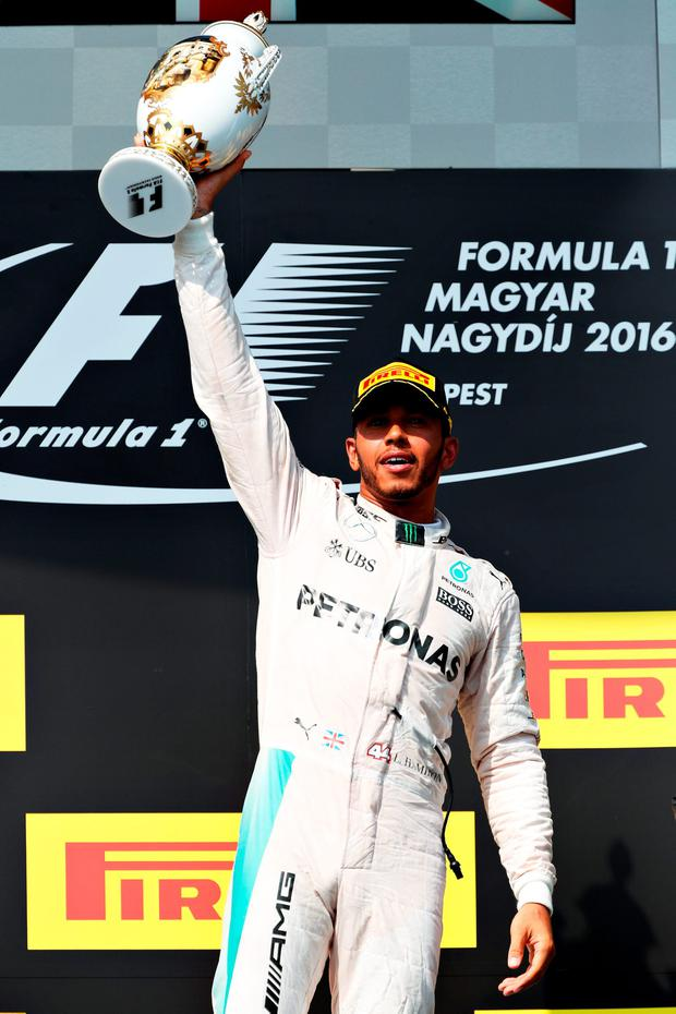 Lewis Hamilton of Great Britain and Mercedes GP celebrates on the podium during the Formula One Grand Prix of Hungary at Hungaroring on July 24, 2016 in Budapest, Hungary. (Photo by Mark Thompson/Getty Images)