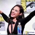 "Gal Gadot makes a Wonder Woman pose at the ""Wonder Woman"" panel on day 3 of Comic-Con International. (Photo by Chris Pizzello/Invision/AP)"