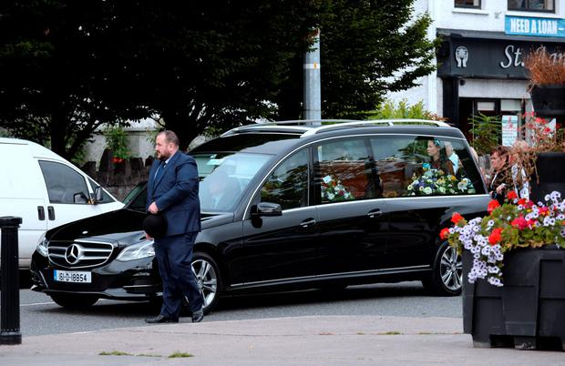 Hearse making its way to the church at funeral of Paul Curran. St. Agnes' Church, Crumlin Village, Dublin. Picture: Caroline Quinn