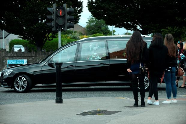 Hearse making its way to the church at funeral of Paul Curran. St. Agnes' Church, Crumlin Village, Dublin.