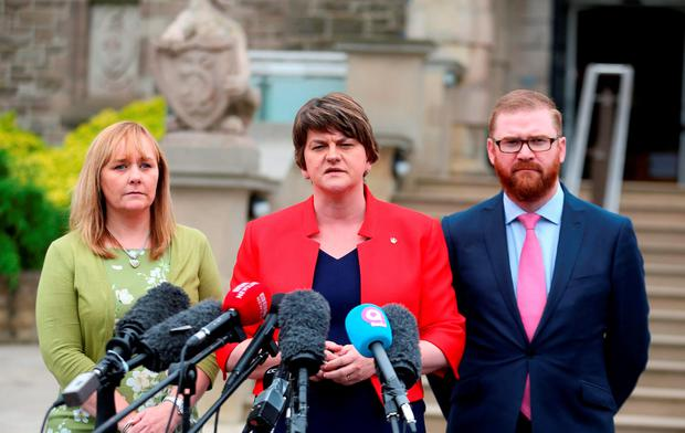 First Minister Arlene Foster (centre) speaks to the media with Agriculture Minister Michelle McIlveen (left) and Economy Minister Simon Hamilton, after meeting with Prime Minister Theresa May at Stormont Castle in Belfast, where she said that the UK's departure from the European Union (EU) must work for Northern Ireland Credit: Liam McBurney/PA Wire