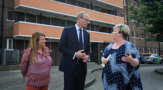 Minister for the Environment, Community & Local Government Simon Coveney TD (centre) with local residents (L to r) Debbie Mulhall & Veronica Lally during the announcement of details of the Regeneration Scheme for Dolphin's Barn at The Community Centre in DolphinÄôs Barn Dublin