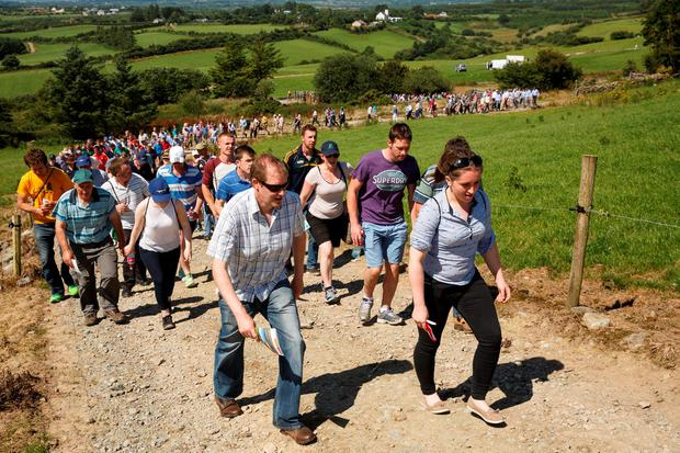 Visitors making their way up the 950ft climb to the Creedon's milking platform. Photo: Donal O'Leary