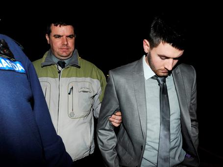 Anthony Hussey (right) is led out of court by gardaí after he was arrested in 2014. Photo: Michelle Cooper Galvin