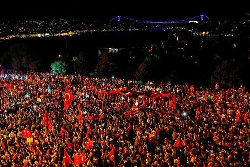 Pro-government supporters protest on the road leading to Istanbul's iconic Bosporus Bridge, not seen, late Thursday, July 21, 2016