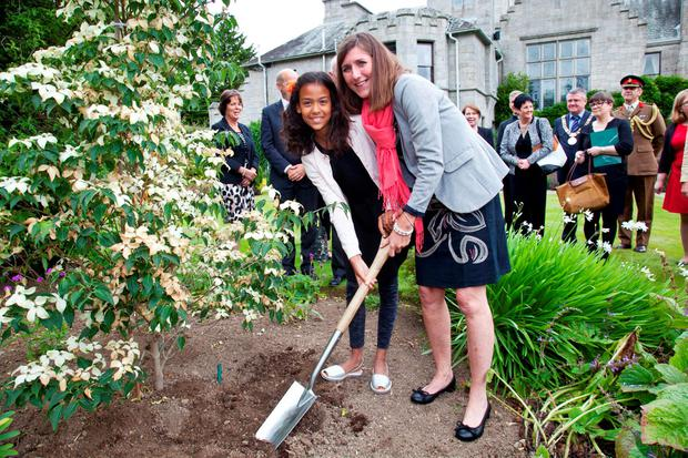 Kate Ewart-Biggs, daughter of Christopher Ewart-Biggs, and her daughter Mairlie plant a tree in memory of the former British ambassador to Ireland. Photo: Paul Sherwood