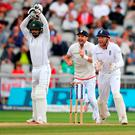 Pakistan batsman Mohammad Hafeez is caught by Gary Ballance (r) off the bowling of Moeen Ali during day four of the 2nd Investec Test match between England and Pakistan at Old Trafford. Photo by Stu Forster/Getty Images