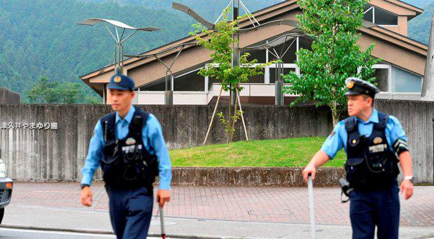 Police officers are seen in front of a facility for the disabled where at least 19 people were killed and as many as 20 wounded by a knife-wielding man, in Sagamihara, Kanagawa prefecture, Japan, in this photo taken by Kyodo July 26, 2016.
