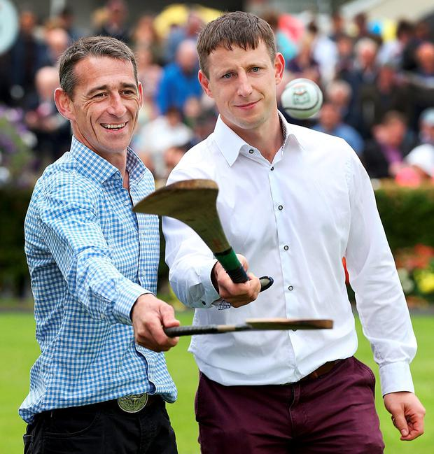 Two-time National Hunt Champion Jockey Davy Russell gets a few pointers from Kilkenny's John Tennyson ahead of the cancer fundraiser. Photo: Steve Humphreys