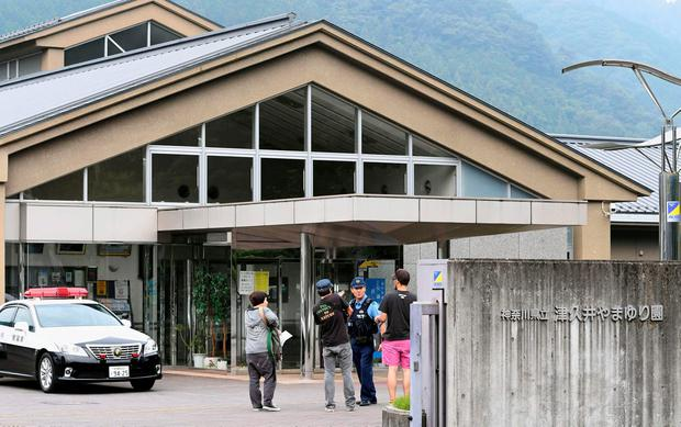 A police officer is seen in a facility for the disabled, where a knife-wielding man attacked, in Sagamihara, Kanagawa prefecture, Japan, in this photo taken by Kyodo July 26, 2016