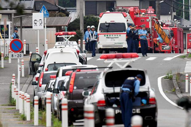 Police officers are seen near a facility for the disabled where at least 19 people were killed and as many as 20 wounded by a knife-wielding man, in Sagamihara, Kanagawa prefecture, Japan, in this photo taken by Kyodo July 26, 2016