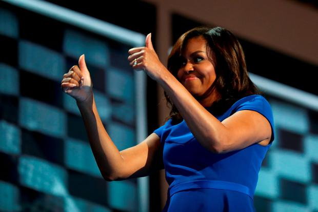 First lady Michelle Obama gives two thumbs up to the crowd after delivering remarks on the first day of the Democratic National Convention