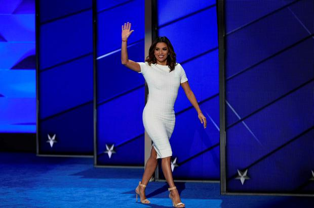 Eva Longoria waves as she arrives on stage during Day 1 of the Democratic National Convention at the Wells Fargo Center in Philadelphia