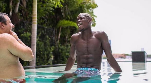 Raiola and Pogba enjoy a dip in a swimming pool