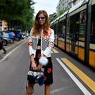 Fashion blogger Chiara Ferragni poses outside the Fendi show during the 2015 Spring / Summer Milan Fashion Week