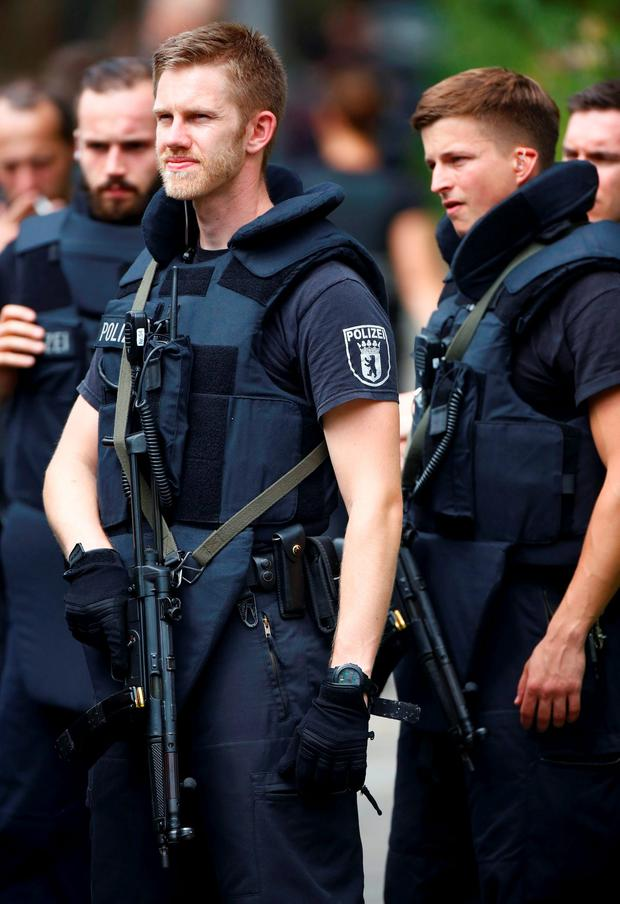 Special police stand outside the university clinic in Steglitz, a southwestern district of Berlin, July 26, 2016 after a doctor had been shot at and the gunman had killed himself. REUTERS/Hannibal Hanschke