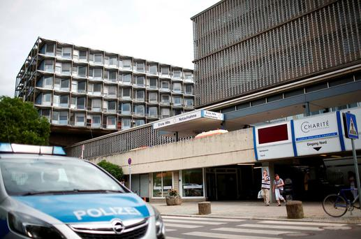 A police car is parked in front of the university clinic in Steglitz, a southwestern district of Berlin, July 26, 2016 after a doctor had been shot at and the gunman had killed himself. REUTERS/Hannibal Hanschke