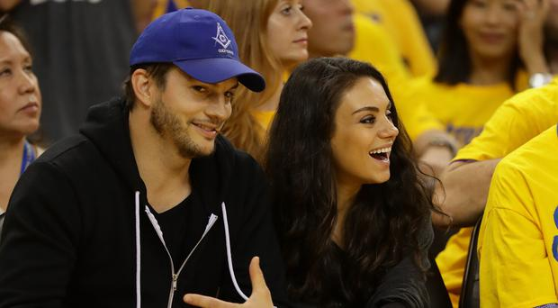 Actors Ashton Kutcher and Mila Kunis attend Game 2 of the 2016 NBA Finals between the Golden State Warriors and the Cleveland Cavaliers at ORACLE Arena on June 5, 2016 in Oakland, California. (Photo by Ezra Shaw/Getty Images)